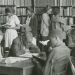 Library Scene African-American High School Age Students Reading Standing or Seated