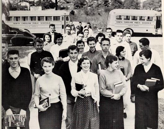 Students heading to a day of school at Jonesville High School, as featured in the 1956 East Bend Whispers yearbook.