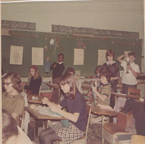 Sixth graders create puppets in Helen Poole's class. January 1968