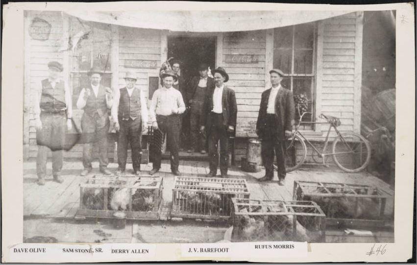 Men outside of a store in Benson, N.C.