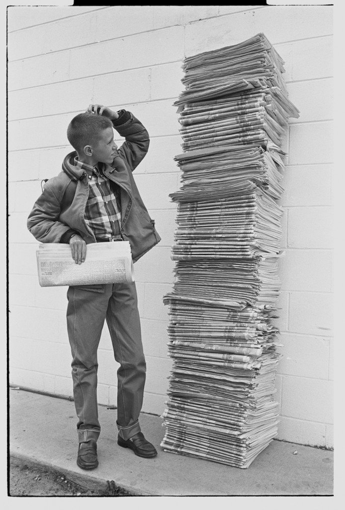 Carrier boy with newspapers. 1965, Courtesy East Carolina University Digital Collections