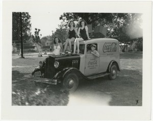 Girls at pool sitting on the Coca-Cola truck
