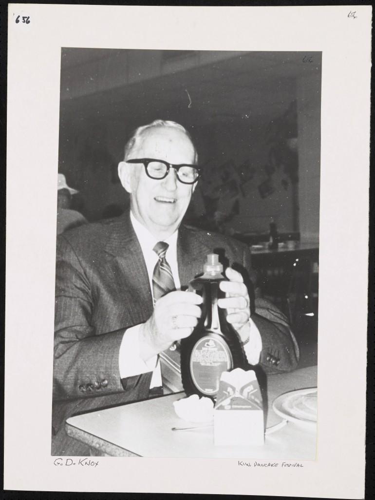 Man holding syrup bottle
