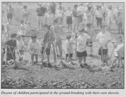 Ground is broken for the Shalom Park Expansion in April 2002 with families from the community participating.