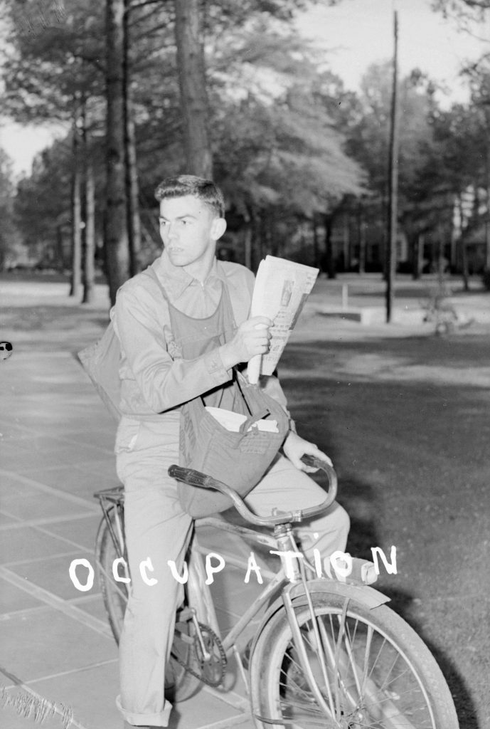 Young Man on Bicycle for Newspaper Delivery, photo by Albert Rabil, April 23, 1951. Courtesy the Braswell Memorial Library.
