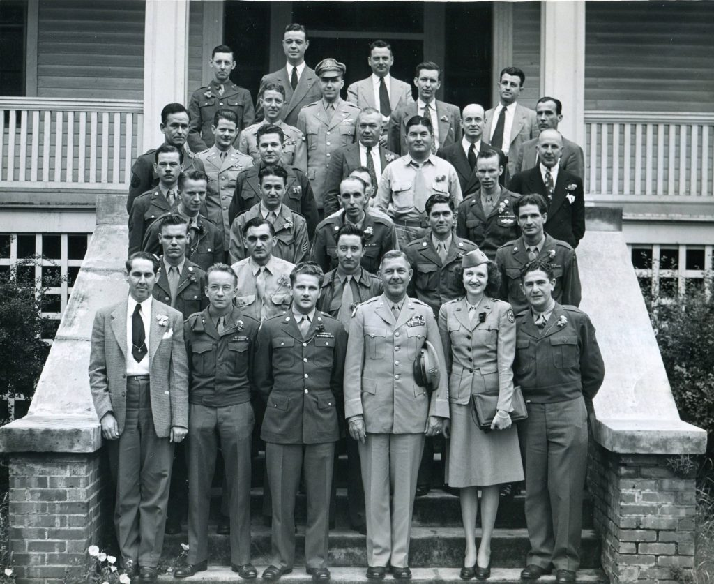 Group of Soldiers Posed with Firestone Officials, from the Gaston Museum of Art & History.