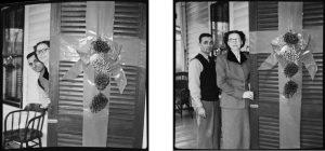 couple_pose_for_christmas_cards_by_peeking_around_door