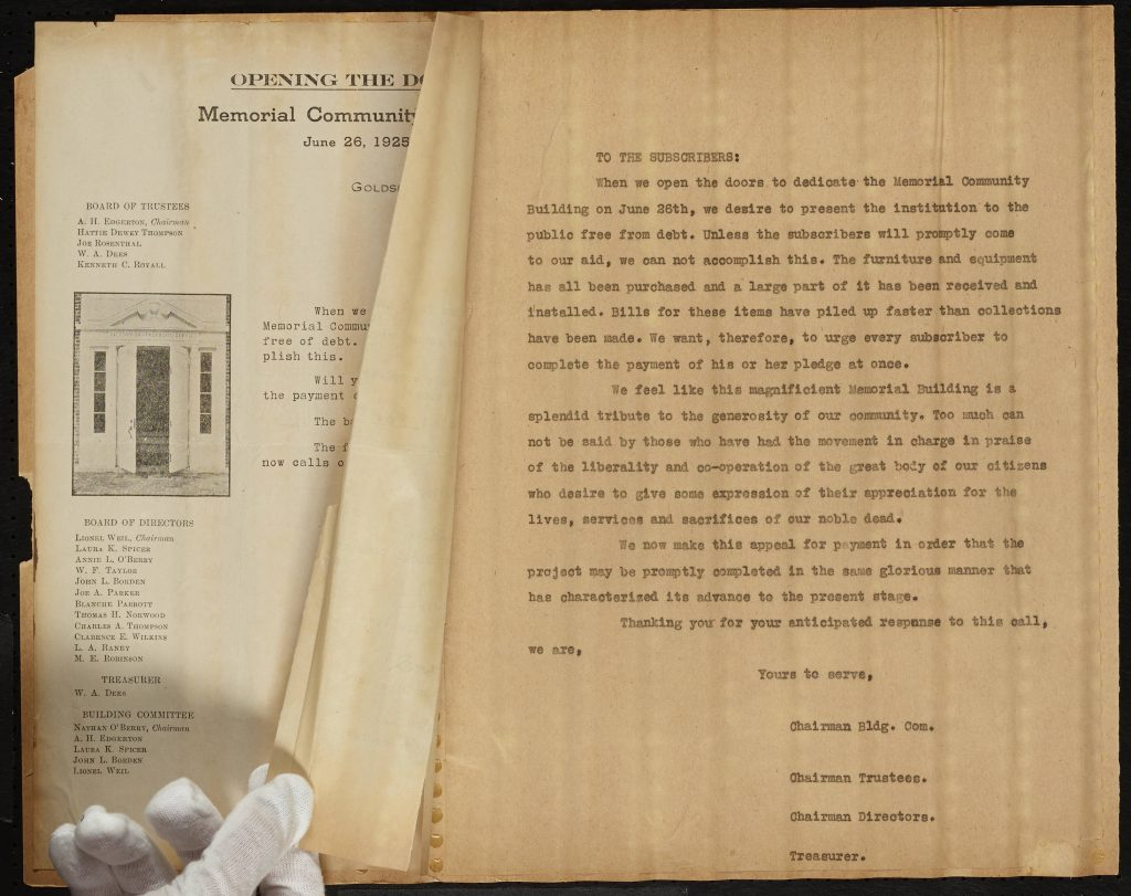 A Wayne County scrapbook page that includes the gloved hand of the student scanner.
