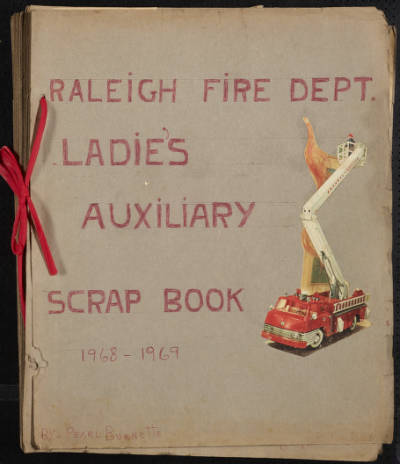 Cover page of Raleigh Fire Department women's group scrapbook, features a firetruck illustration