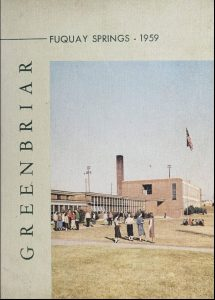 Cover of the Fuquay Springs High School yearbook showing women standing outside the school