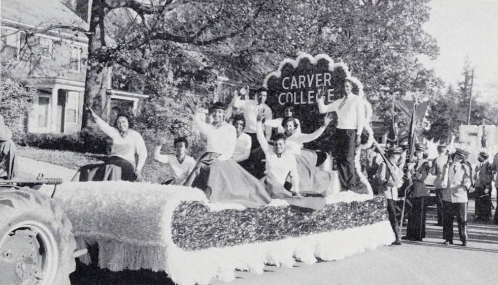 Carver Junior College waving on parade float.
