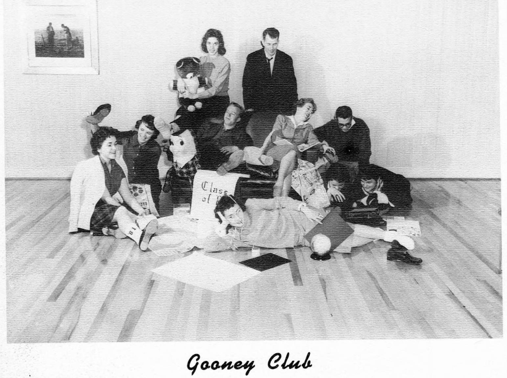 "High schoolers sprawled out and collapsed around a chair, with the caption ""gooney club"""