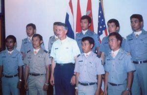 Ten individuals in uniform standing in a group facing forward