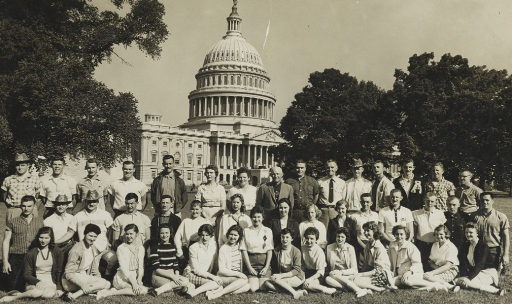 students and chaperones in a group photo with the US Capitol in the background