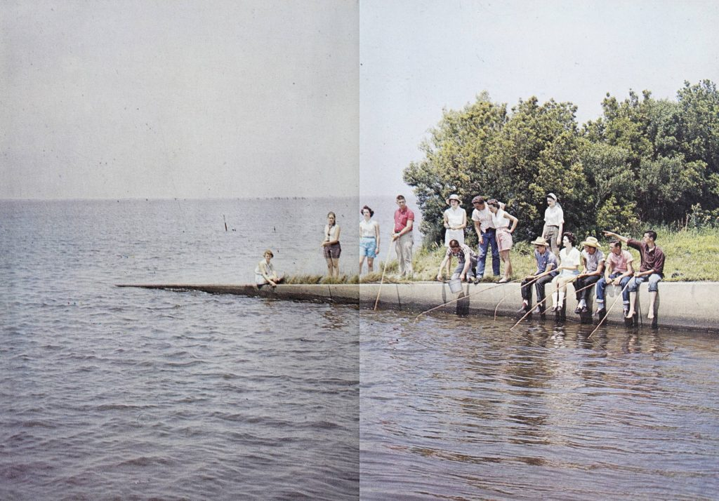 high school aged students sitting or standing near the ocean, some with fishing poles