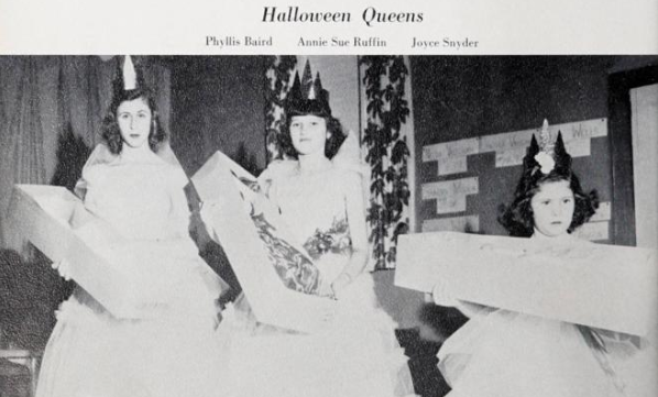 "Photo of three Ahoskie High School students dressed up as ""Halloween Queens""."