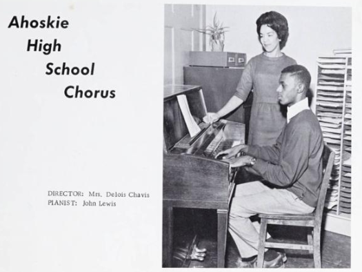 Photo of Ahoskie High School chorus director and student at a piano.