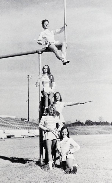 Photo of majorettes posing on the football field at Kings Mountain High School in 1969.