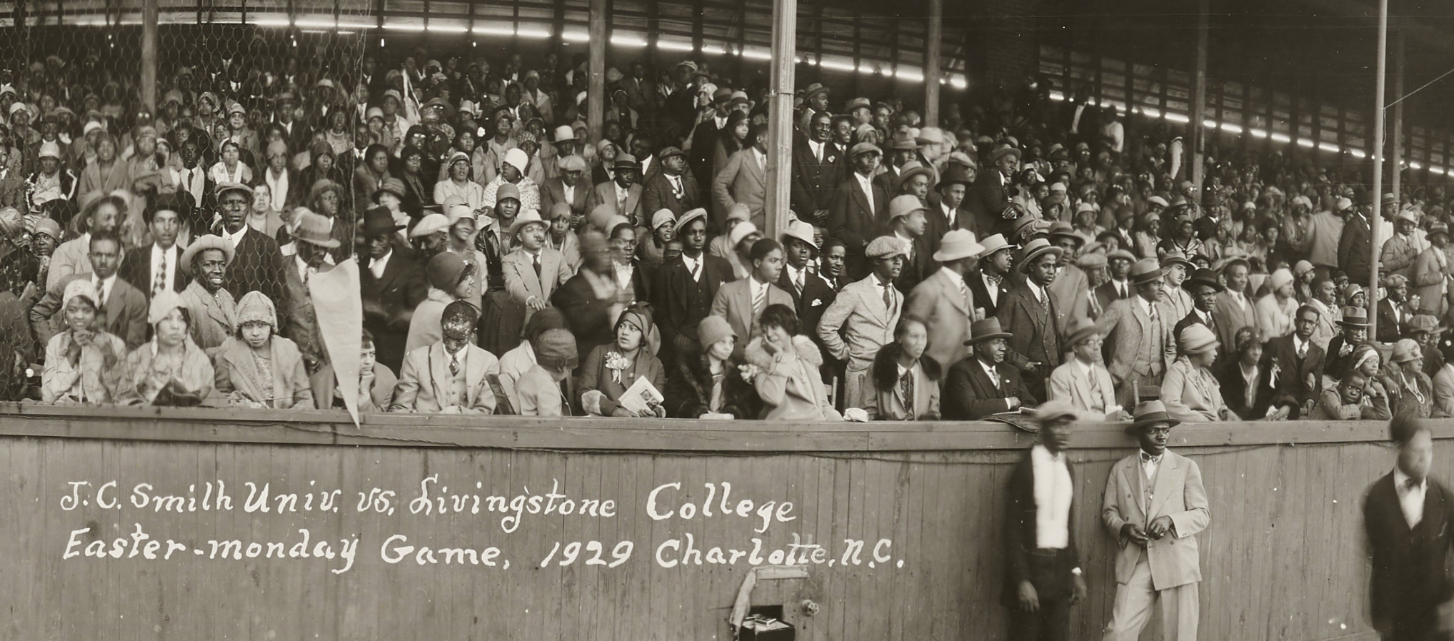 Close up of the crowd in the stands watching a baseball game.