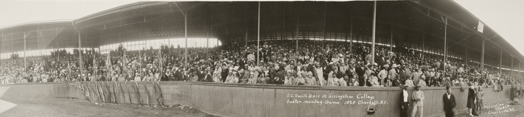 Panoramic photo of the crowd watching a baseball game from the stands.