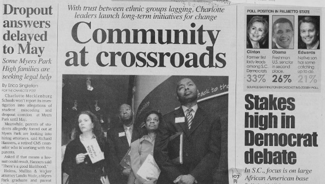 "Clipping from the front page of The Charlotte Post. The headline reads ""Community at Crossroads"" and features a photo of four Johnson C. Smith University officials standing in a row. There is also a poll showing the current lead for Democratic presidential candidate in Palmetto County. Hillary Clinton leads with 33%, followed by Barack Obama with 26%, and John Edwards with 21%."