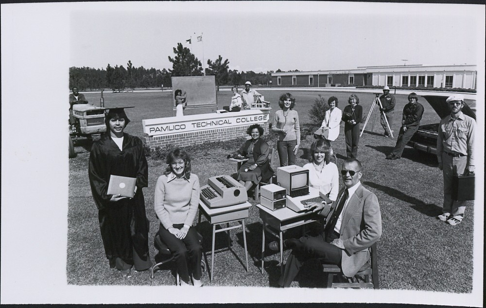 Students and faculty standing on the lawn at the new Pamlico Technical College building representing various areas of study.