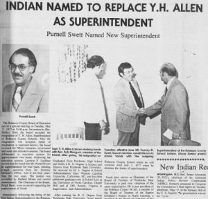 "Clipping of a front page article. The title is ""Indian Named to Replace Y.H. Allen as Superintendent"". There is a headshot of new superintendent Purnell Swett and a photo of two adults shaking hands while another adult stands to the left."