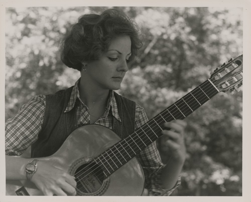 Gail George playing a guitar