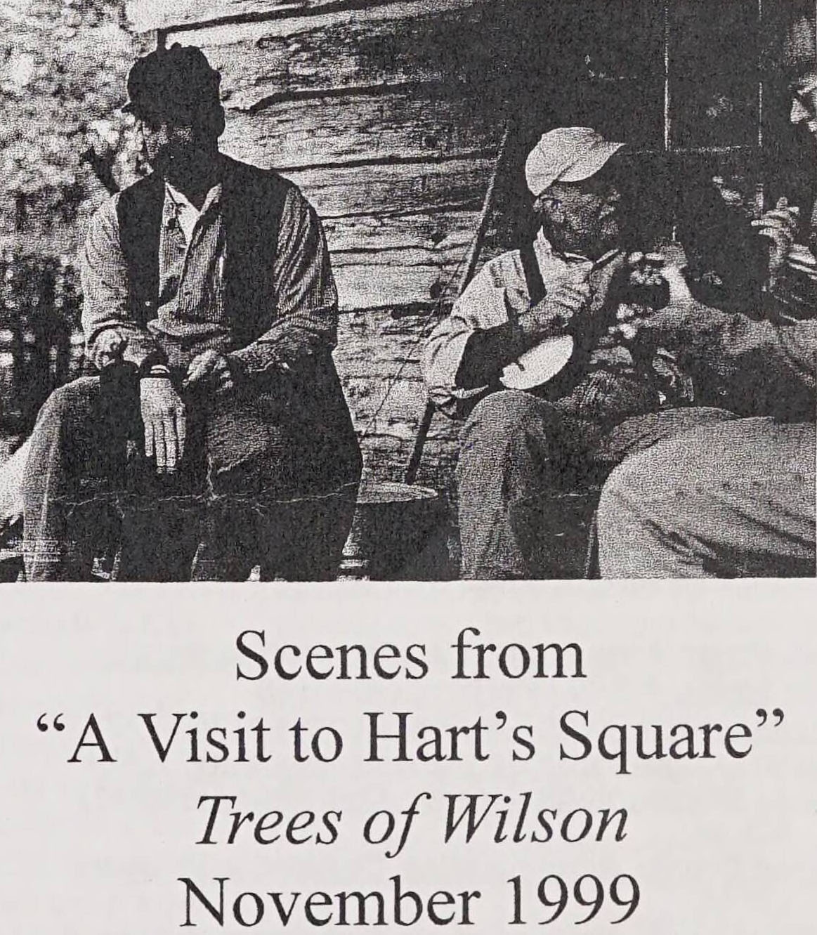 """Scenes from """"A Visit to Hart's Square"""" Trees of Wilson, November 1999. Above the words is a picture of three adults sitting. One is holding a banjo, a second a guitar. The third has no instrument."""