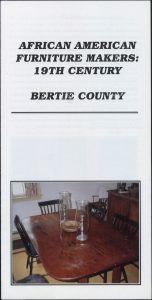 Brochure with a color picture of a table with 4 chairs around it