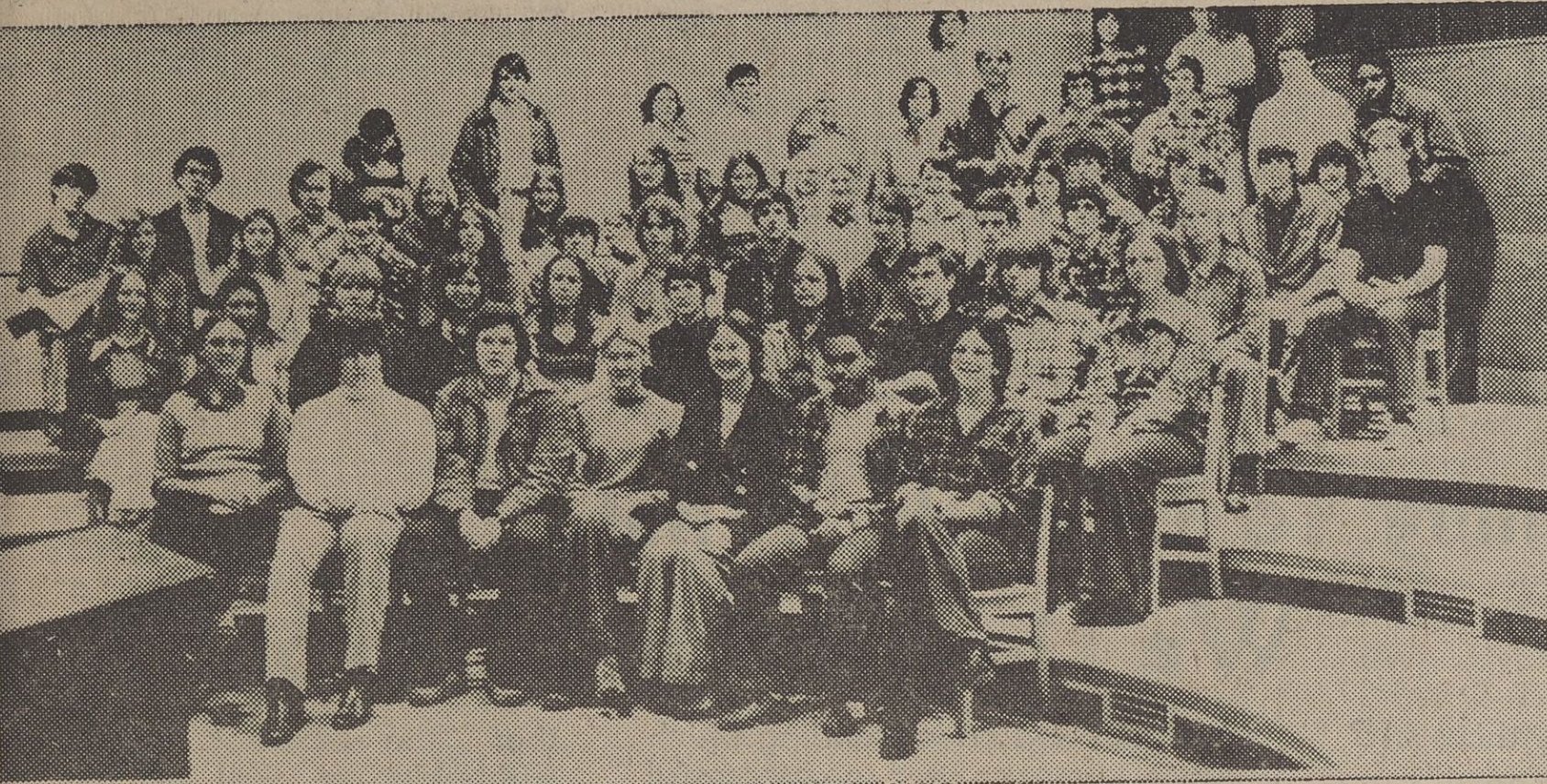 A group of band students sitting on risers.